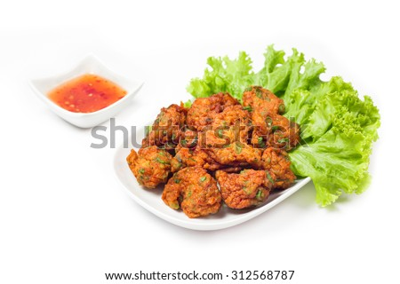Thai fried fish cake (Tod Mun Pla) or prawn fritter ball serve with red sauce Thai  traditional food recipe isolated on white background  - stock photo