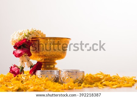 Thai garland Flowers in tray with pedestal with marigold corolla for songkran festival in Thailand. - stock photo