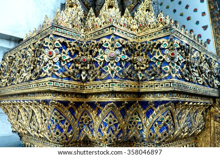 Thai Glass Mosaic wall decorative ornament from colorful glass in Wat Phra Chetuphon Vimolmangklararm Rajwaramahaviharn Temple (Locally known as Wat Pho Buddhist Temple), Bangkok, Thailand - stock photo