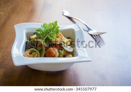 Thai Green Curry Shrimp with Vegetables Over Rice  - stock photo