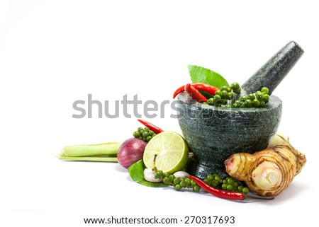 Thai herb ingredient, spicy food in mortar isolated on white background - stock photo