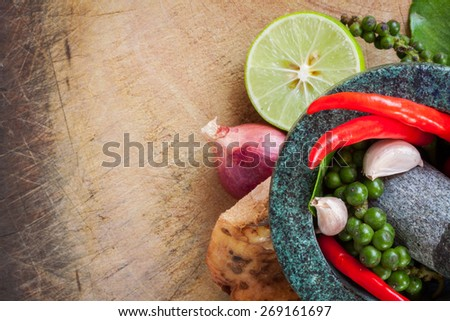 thai herb ingredient, spicy food on a wooden background - stock photo