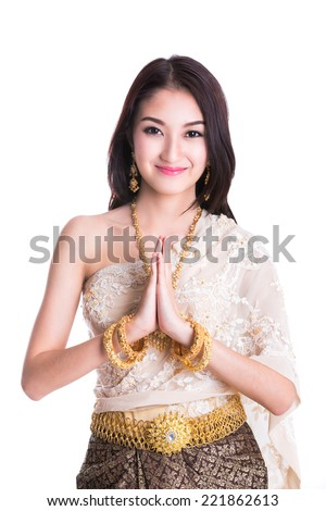 Thai Lady in vintage original Thailand attire Sawasdee action (welcome in thai style) - stock photo