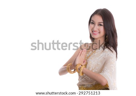 Thai Lady in vintage original Thailand attire Sawasdee action (welcome in thai style) - stock photo