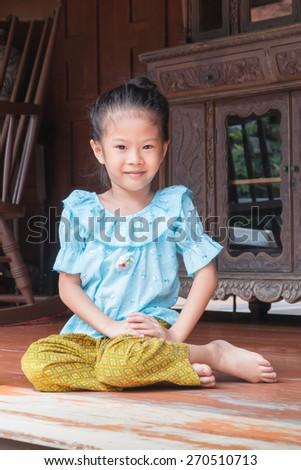 Thai little girl in Thai traditional dress - stock photo