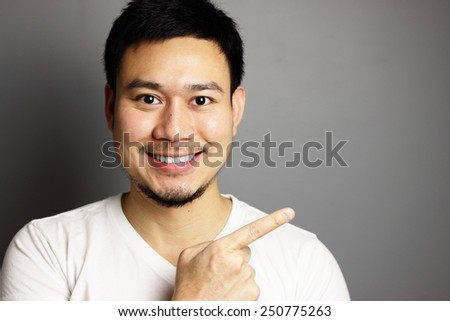 Thai man pointing out. - stock photo