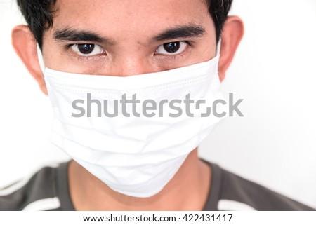 thai man wear face polution mask on white background - stock photo