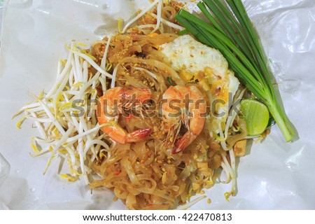 Thai noodle or padthai,garnish,vegetable,shrimp on wrapping paper - stock photo