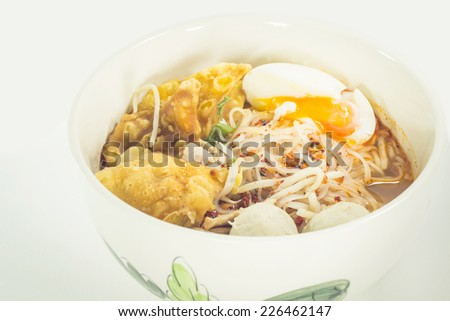 Thai noodle soup in a bowl on a white background taste spicy noodle soup - stock photo