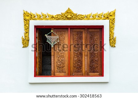 thai painting in wooden window - stock photo