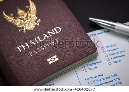 Thai Passport and customs form and pen. concept of travel and business. - stock photo
