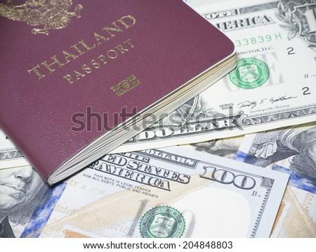 Thai Passport on banknotes - stock photo