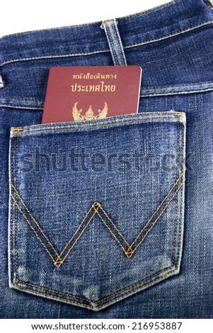 Thai passports in jean pocket. - stock photo