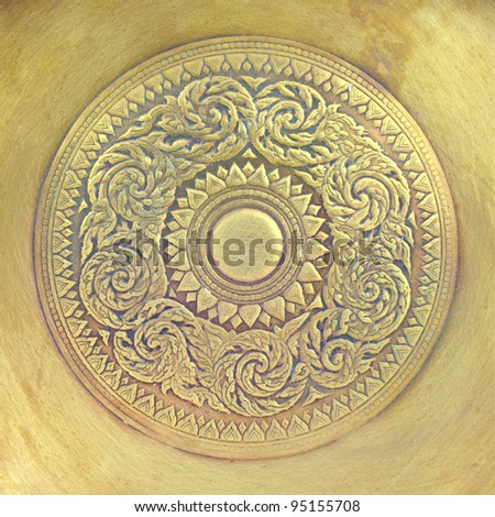 Thai pattern on old brass plate - stock photo