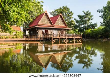Thai pavilion reflect in pool - stock photo