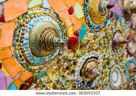 "Thai porcelain with designs in five colours / Colorful of wall. Made from "" Benjarong "" - stock photo"
