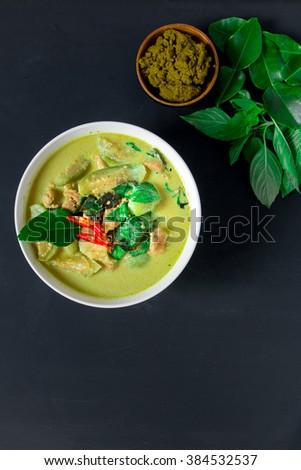 Thai pork green curry on black background - stock photo