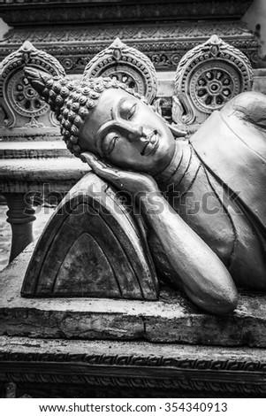 Thai Reclining Buddha Statue - stock photo