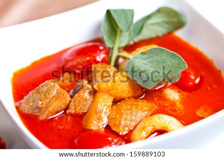 Thai Red curry with duck breast, lychees and cherry tomato flavored with basil, entree  - stock photo