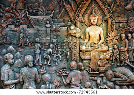 thai rural life stone mural - stock photo