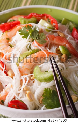 Thai salad yum woon sen with shrimp macro on a plate. vertical - stock photo