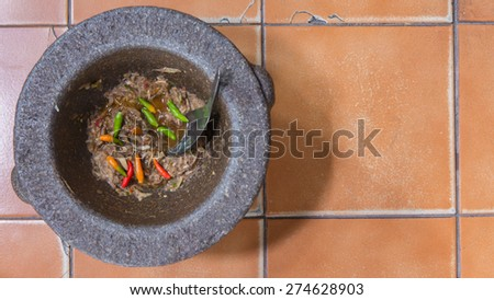 Thai Shrimp Paste Chile Sauce. (In Thai called Nam Prik Kapi) in Mortar and pestle - stock photo