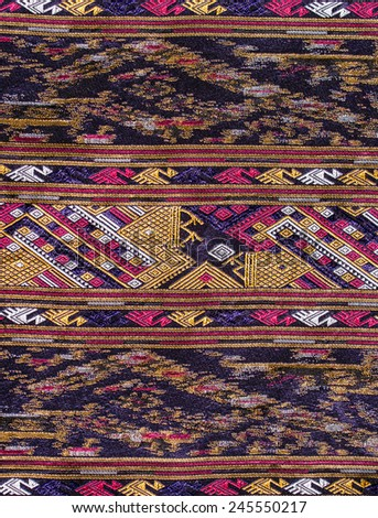 Thai silk pattern close up texture. - stock photo