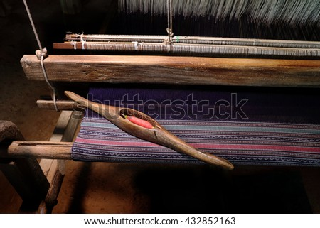 Thai Silk. wooden weaving shuttle for homemade silk or textile production - stock photo