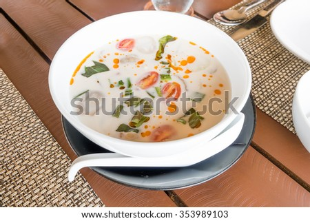 Thai soup made from coconut milk, mushrooms and chicken - stock photo