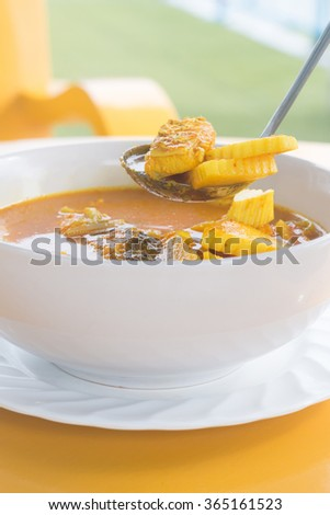 Thai Southern food. spicy sour flavor curry mixed with fish meat, sliced bamboo shoot. - stock photo