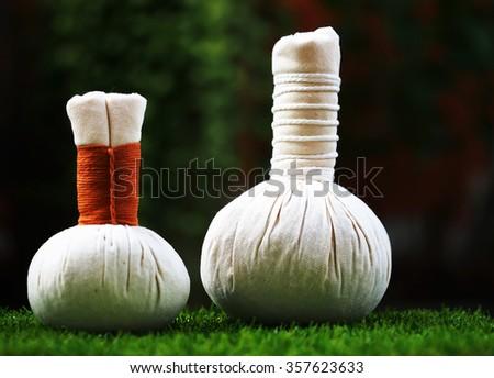 Thai spa massage compress balls , herbal ball with flower. Spa Thailand - stock photo