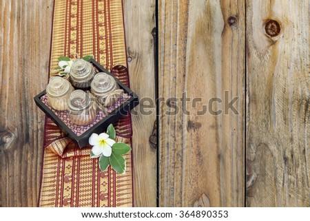 Thai spa massage setting herbal on wood background - stock photo