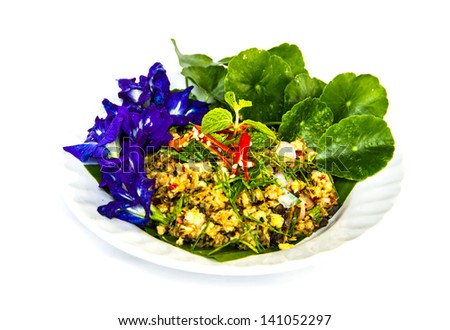 thai spicy  fish salad with blue herbal flower and green vegetable - stock photo