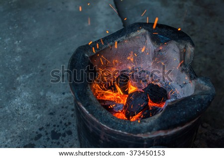 Thai stove, cooking tool. Traditional charcoal burning clay stove in a rustic wooden house. - stock photo