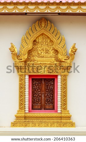 Thai style golden carving wooden window - stock photo
