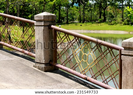 Thai style steel fence in the park - stock photo