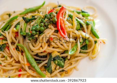 thai style stir-fried spicy spaghetti, Stir-fried spicy spaghetti - stock photo