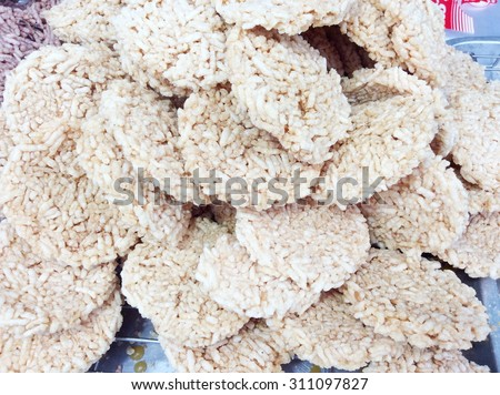 Thai Sweet Crispy Rice Cracker , Crispy Rice with watermelon,rice fired and syrup on top, soft focus - stock photo