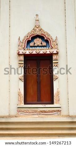 Thai temple door sculpture in Lopburi province - stock photo