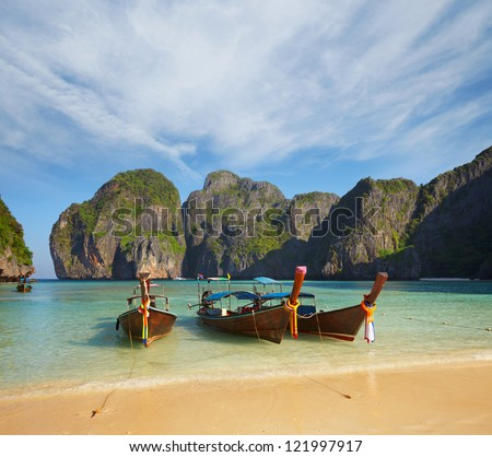 Thai traditional boats in the bay. Thailand, Phi Phi Island - stock photo