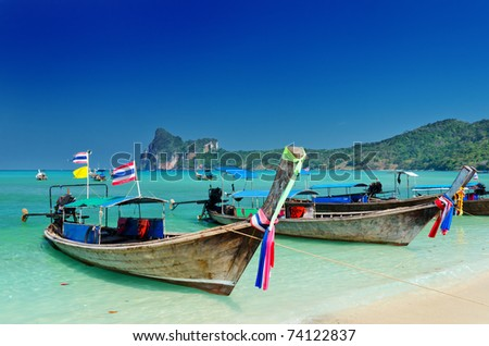 Thai traditional boats on Phi-Phi island. - stock photo