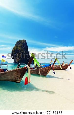 Thai traditional boats on Railay Beach, Krabi. - stock photo