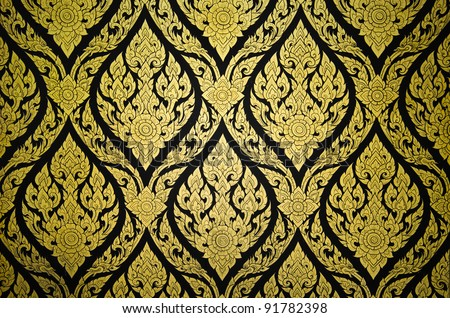 Thai traditional floral pattern textured on a wall - stock photo
