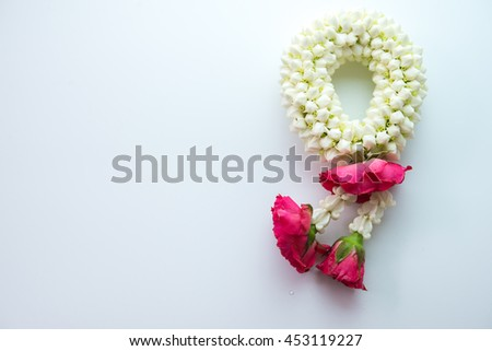 Thai traditional jasmine garland.symbol of Mother's day in thailand, to offer the monk or buddha. - stock photo
