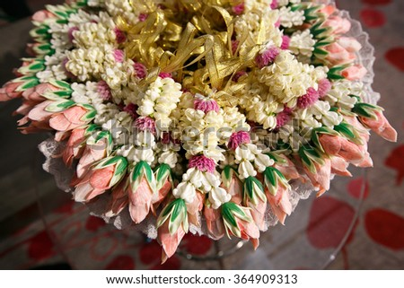 Thai Traditional Style of garland made from Roses and jasmine isolated  - stock photo
