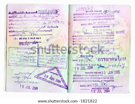 Thai visas in a passport with clipping path - stock photo