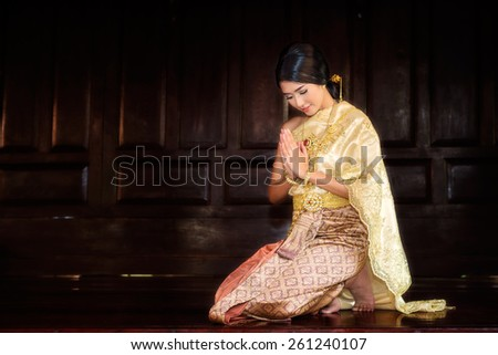Thai Woman In Traditional Costume Of Thailand in ancient house at Ayutthaya - stock photo