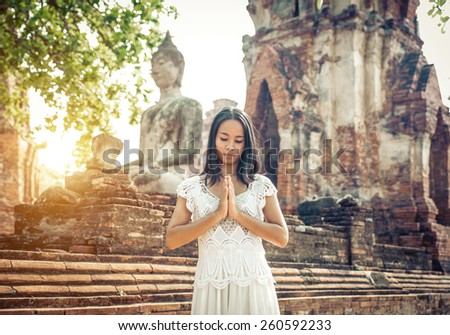 thai woman praying in Ayutthaya. concept about religion and landmarks - stock photo