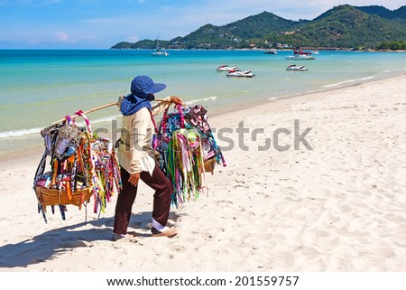 Thai woman selling beachwear at beach in Koh Samui, Thailand. - stock photo