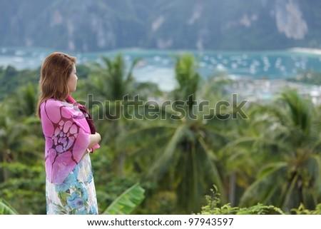 thai woman watching ko phi phi island landscape, thailand - stock photo